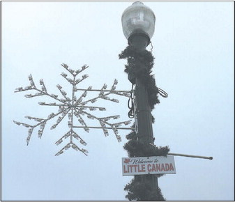 """Sign Welcomes Visitors To  """"Little Canada"""""""